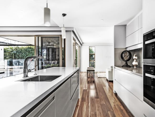 The modern kitchen features a butler's pantry