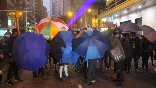 Protesters shield themselves in Hong Kong.