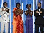 "The cast of ""Black Panther,"" from left, Chadwick Boseman, Danai Gurira, Lupita Nyong'o and Michael B. Jordan doing the ""Wakunda Forever"" salute as they present the award for best animated feature during the 76th Annual Golden Globe Awards. Picture: AP"