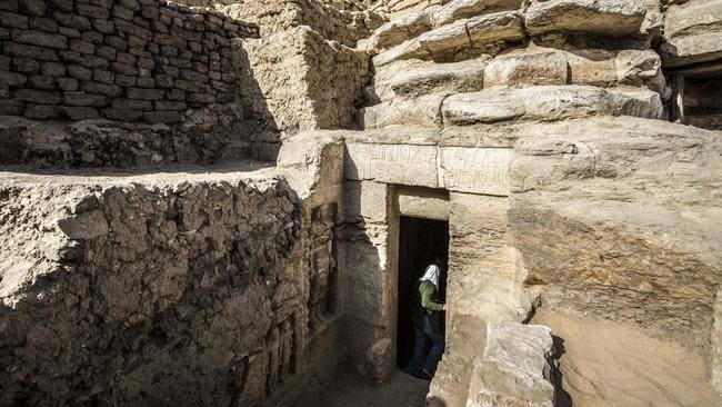 The entrance of a newly-discovered tomb, at the Saqqara necropolis, 30 kilometres south of the Egyptian capital Cairo. Picture: Khaled Desouki / AFP.