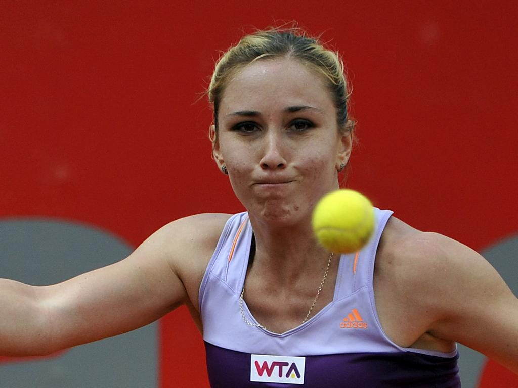 BOGOTA, COLOMBIA - APRIL 10:  Georgian tennis player Sofia Shapatava returns the ball to Serbian Jelena Jankovic, during their WTA Bogota Open match at El Rancho Club on April 10, 2014 in Bogota, Colombia. (Photo by Gal Schweizer/LatinContent via Getty Images)