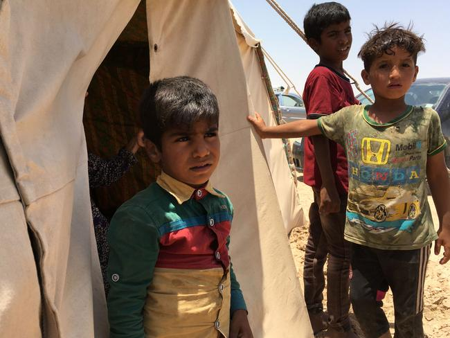Displaced Iraqi boys stand in front of a tent at a newly-opened camp in the government-held town of Amriyat al-Fallujah, 50 kilometres southwest of Baghdad. Picture: Jean Marc MOJON