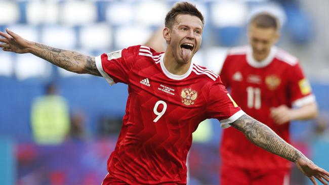 Russia's Fedor Smolov celebrates after scoring his side's second goal.