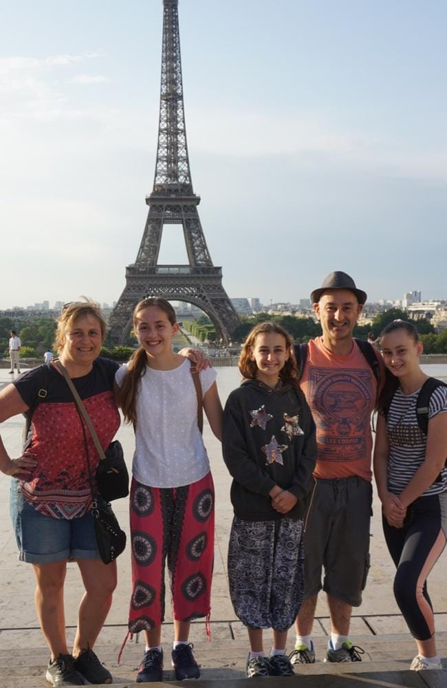 Val, Peter and their daughters went to Paris earlier than planned and say it's important to enjoy life as a family. Picture: Carswell family.