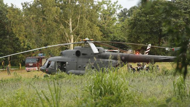A Thai military evacuation helicopter arrives to help rescue the remaining trapped boys and their coach. Picture: AP Photo.