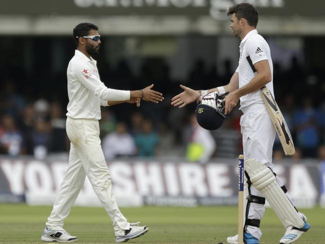 India's Ravindra Jadeja, left, shakes hands with England's James Anderson.