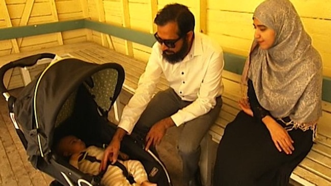Innocent victims ... the couple with their baby son Muhammad.