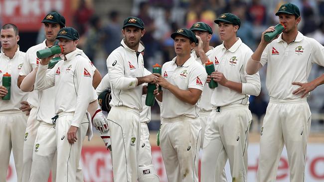 Australia's fielders look on as Cheteshwar Pujara has a dismissal overturned on review.