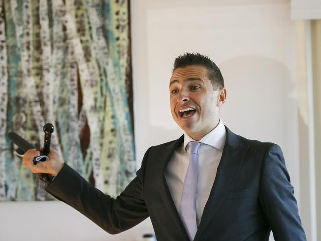 Auctioneer Vic Lorusso at an onsite auction on the northern beaches this month. Thirty-two properties are being auctioned this weekend, May 25.