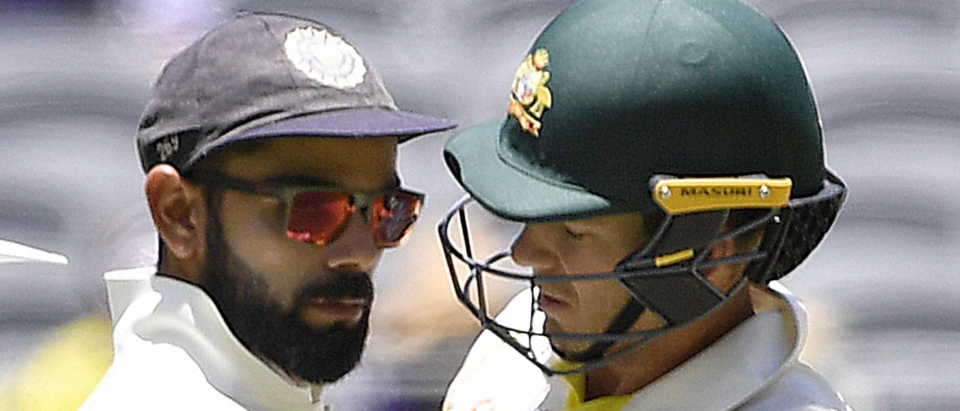 Indian captain Virat Kohli (left) and Australian captain Australian captain Tim Paine touch after Paine ran a single during play on day four of the second Test match between Australia and India at Perth Stadium in Perth, Monday,  December 17,  2018.  (AAP Image/Dave Hunt) NO ARCHIVING, EDITORIAL USE ONLY, IMAGES TO BE USED FOR NEWS REPORTING PURPOSES ONLY, NO COMMERCIAL USE WHATSOEVER, NO USE IN BOOKS WITHOUT PRIOR WRITTEN CONSENT FROM AAP