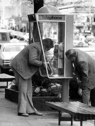 Phone booth on Collins St, Melbourne in 1979.