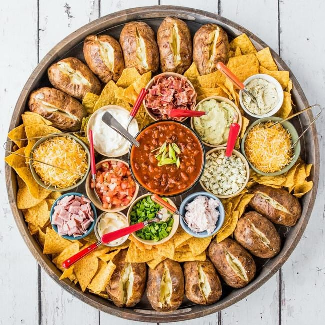 The way to build the platter is to first bake potatoes in their skins then add a selection of tasty sides. Picture: Facebook/The reluctant entertainer