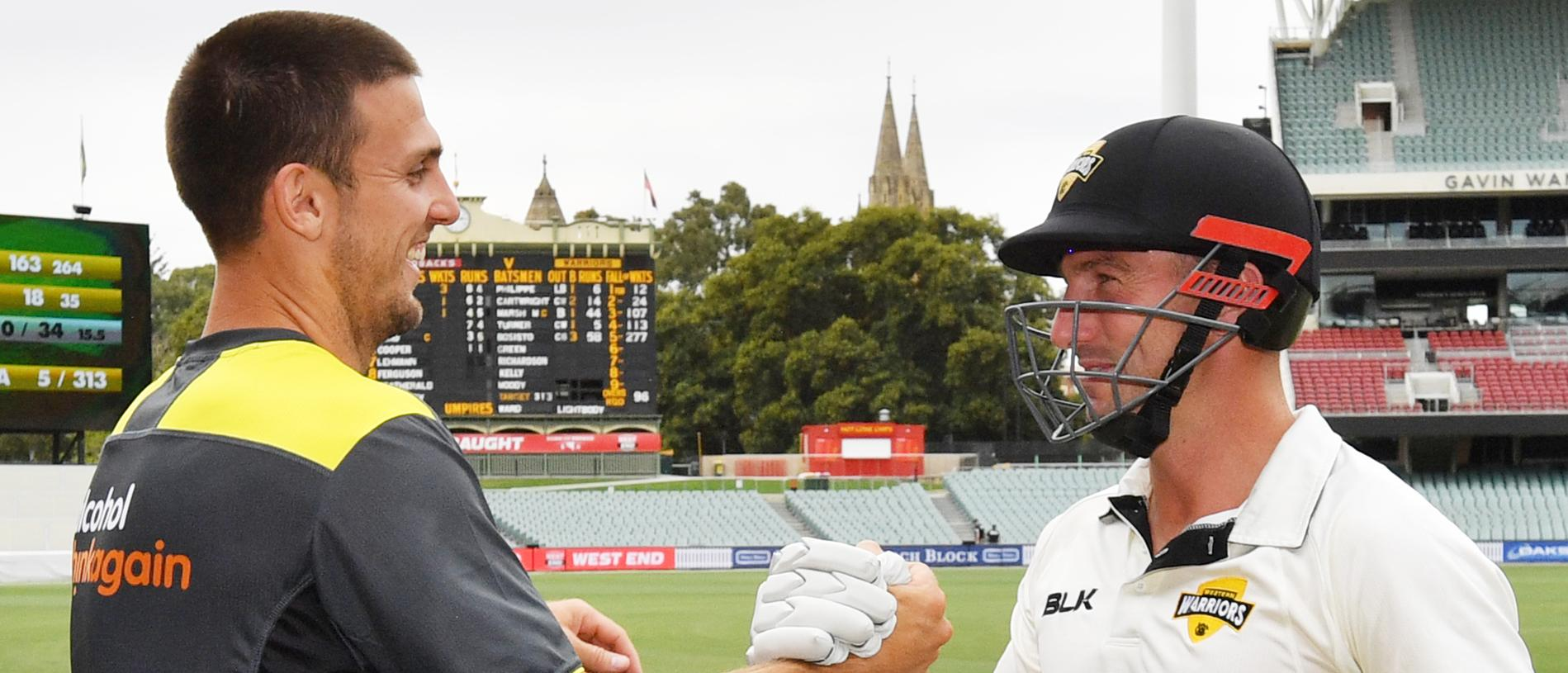 Mitch and Shaun Marsh of the Western Warriors celebrate after winning the game during day 4 of the round 4 of the JLT cricket match between South Australia and Western Australia at the Adelaide Oval in Adelaide, Monday, November 19, 2018. (AAP Image/David Mariuz) NO ARCHIVING, EDITORIAL USE ONLY, IMAGES TO BE USED FOR NEWS REPORTING PURPOSES ONLY, NO COMMERCIAL USE WHATSOEVER, NO USE IN BOOKS WITHOUT PRIOR WRITTEN CONSENT FROM AAP