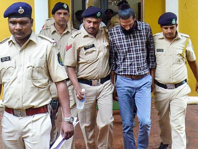 Samson D'Souza leaves surrounded by policemen after being sentenced to ten year imprisonment by the Bombay High Court in Goa. Picture: STR/AFP