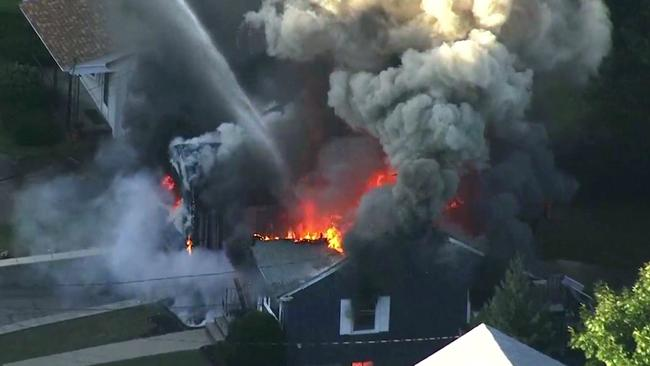 At least 39 homes in three communities north of Boston caught alight. Picture: WCVB via AP