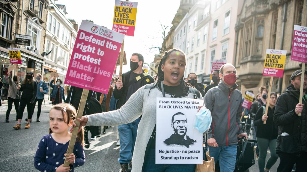 Protesters march to Oxford University's Oriel College. Picture: Laurel Chor/Getty Images