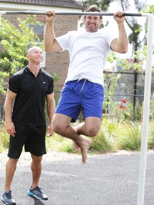 Crocodile hunter Matt Wright shows Adam MacDougall how he trains outdoors. Picture: Cameron Richardson