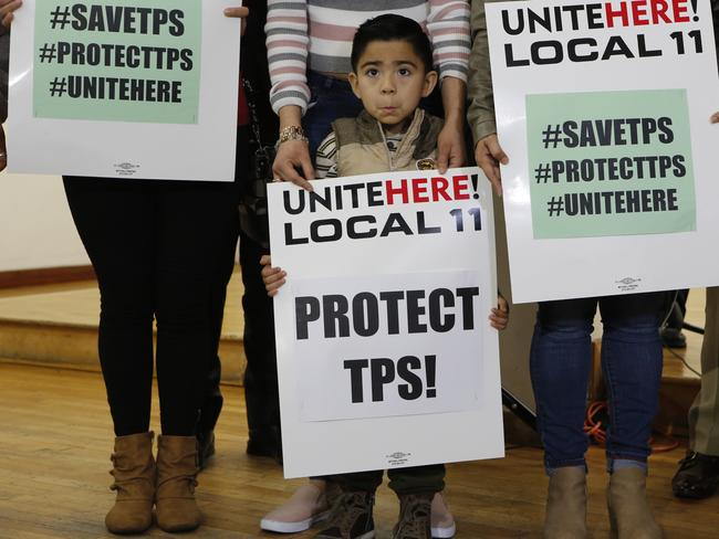 Mateo Barrera, 4 originally from El Salvador, whose family members benefit from Temporary Protected Status, TPS, attends a news conference in Los Angeles. Picture: AP