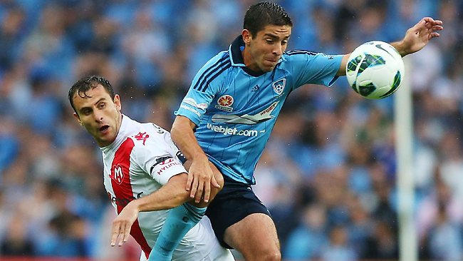 Sydney's Peter Triantis competes for the ball under pressure from Heart's Richard Garcia. Picture: Brendon Thorne