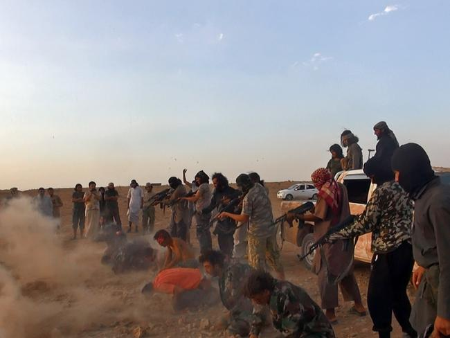 Seven men are made to kneel before being shot by gunmen of the Islamic State group after seizing the Tabqa air base in Raqqa province, Syria. Picture: AP / Raqqa Media Centre of the Islamic State group