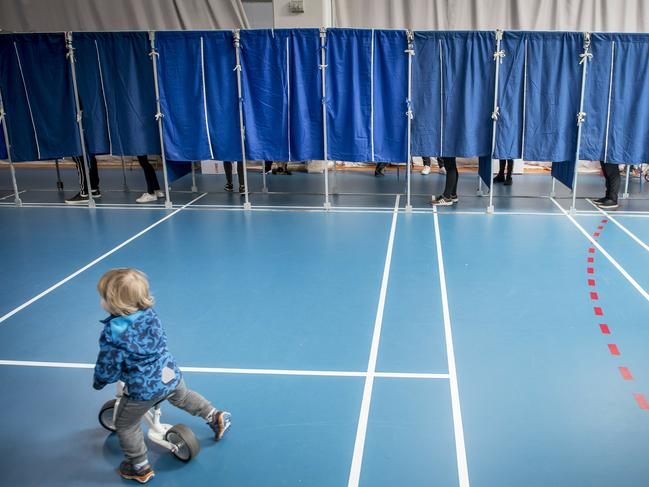 People vote at the Groendal Center in Copenhagen during the European Parliament elections. Picture: Mads Claus Rasmussen/Ritzau Scanpix via AP