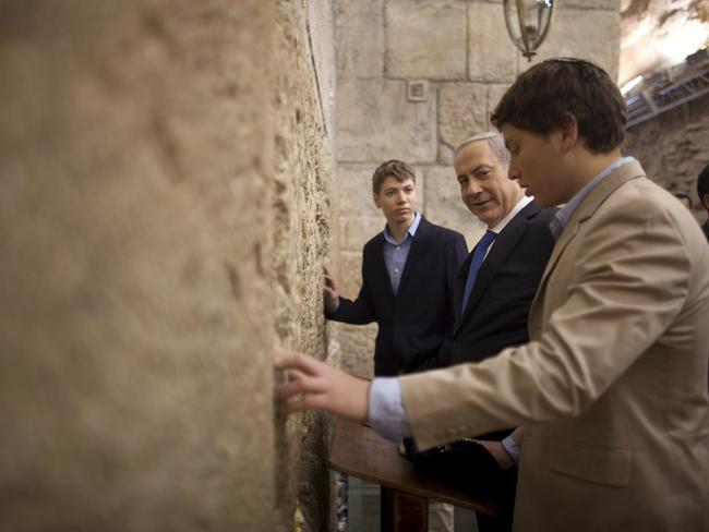 Israeli Prime Minister Benjamin Netanyahu prays with his sons Yair left, and Avner at the Western Wall.