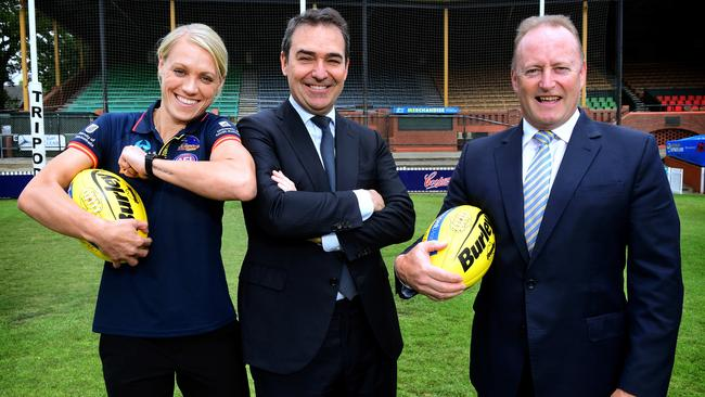 Erin Phillips, Premier Steven Marshall and Adelaide Crows Chairman Rob Chapman pose for a photo after the State Government announced its continued funding of the Adelaide Crows AFLW team at the Parade Oval. Picture: Image AAP/Mark Brake