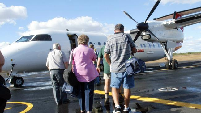 All aboard. Passengers board a QantasLink Dash 8 like that involved in Monday's incident in Canberra Picture: News Corp Australia