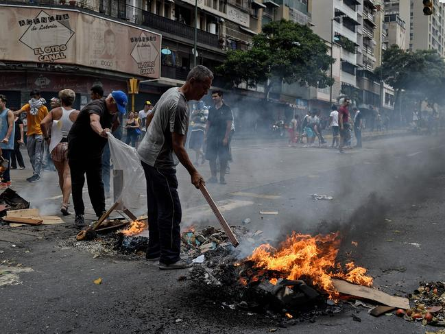 Living conditions are plummeting in the oil-producing Latin American nation, which is spiralling ever deeper into economic chaos during a protracted political crisis. Picture: AFP