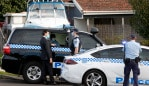 Police at a home on Smith Street in Pendle Hill where a person is believed to have passed away from Covid-19. Picture: Jonathan Ng