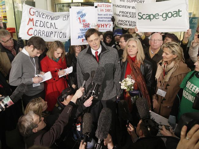 Disgraced doctor Andrew Wakefield (centre), with wife Carmel, addresses the media in London after authorities revoked his medical licence. Picture: AFP