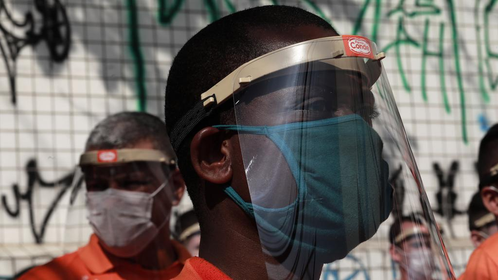 A cleaning crew member prepares to disinfect the streets of Paraisopolis Favela as a precaution against the coronavirus pandemic. Image: Rodrigo Paiva / Getty Images