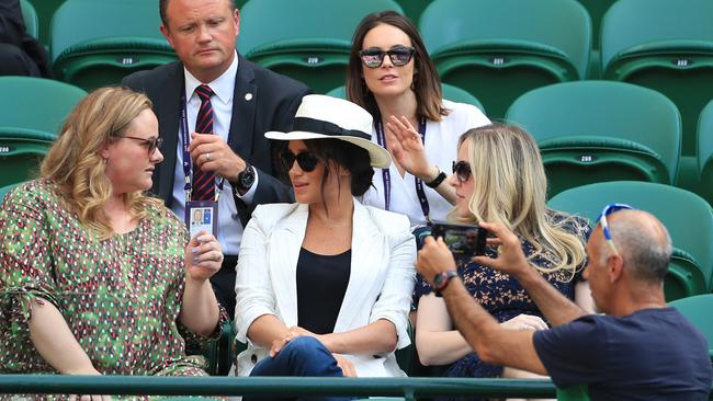 It was later revealed the spectator was taking a selfie — and not a sneaky snap of the Duchess. Picture: Mike Egerton/PA Wire