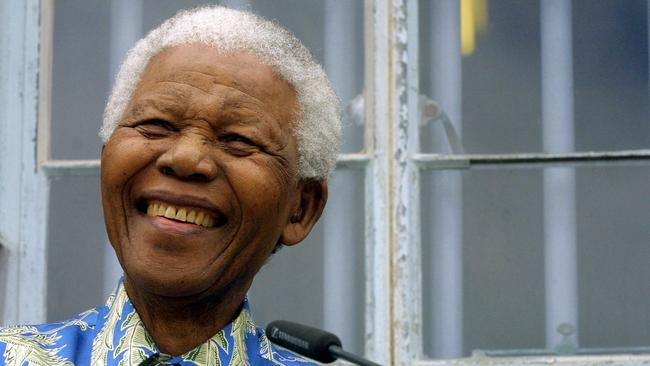 Former South African President Nelson Mandela during a press conference in front of his former prison cell on Robben Island in 2003.