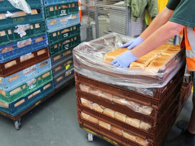 Inmates at Long Bay jail prepare bread for feeding prisoners across the state. Picture: Courtesy CSNSW.
