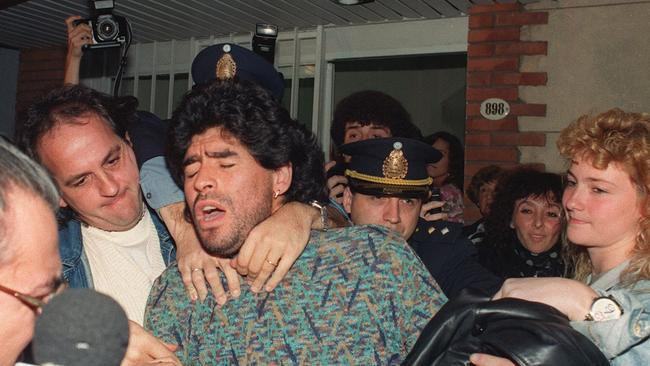 Diego Maradona is removed by police from a Buenos Aires apartment, on April 26, 1991, after being arrested for the possession of a half-kilo of cocaine.