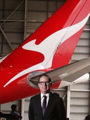 Alan Joyce, CEO of Qantas, with the new logo. Picture: Chris Pavlich