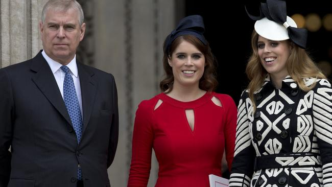 Prince Andrew with Princess Eugenie and Princess Beatrice. Picture: Justin Tallis/AFP