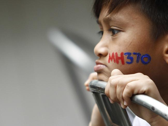 A Malaysian child has his face painted with MH370 during a remembrance event in 2016. Picture: AP