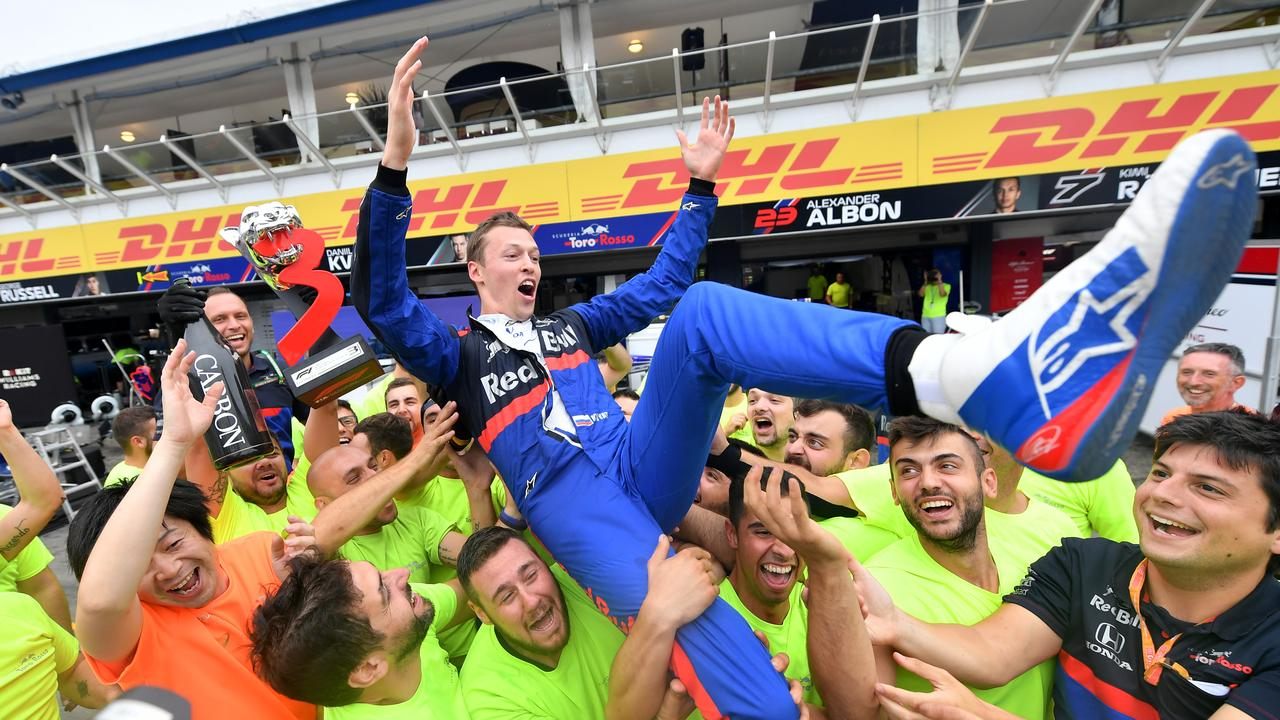 Third placed Kvyat celebrates with his team after the race.