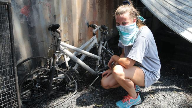 Montana Clark, with what' left of her bikes. Picture: AAP / Dean Martin