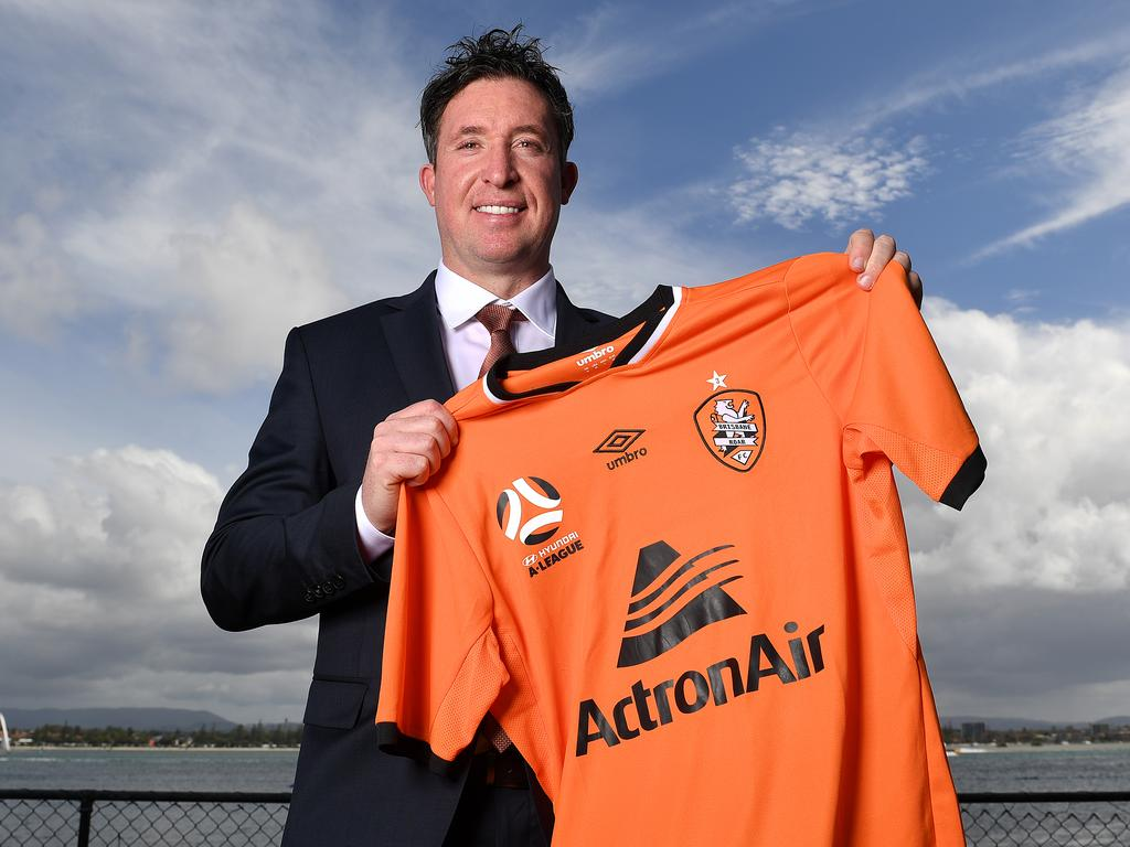 Former Liverpool football player Robbie Fowler poses for a photograph with a Brisbane Roar jersey following a press conference at Sea World on the Gold Coast, Tuesday, April 23, 2019. Fowler has been named as the Brisbane Roar's new Head Coach. (AAP Image/Dave Hunt) NO ARCHIVING