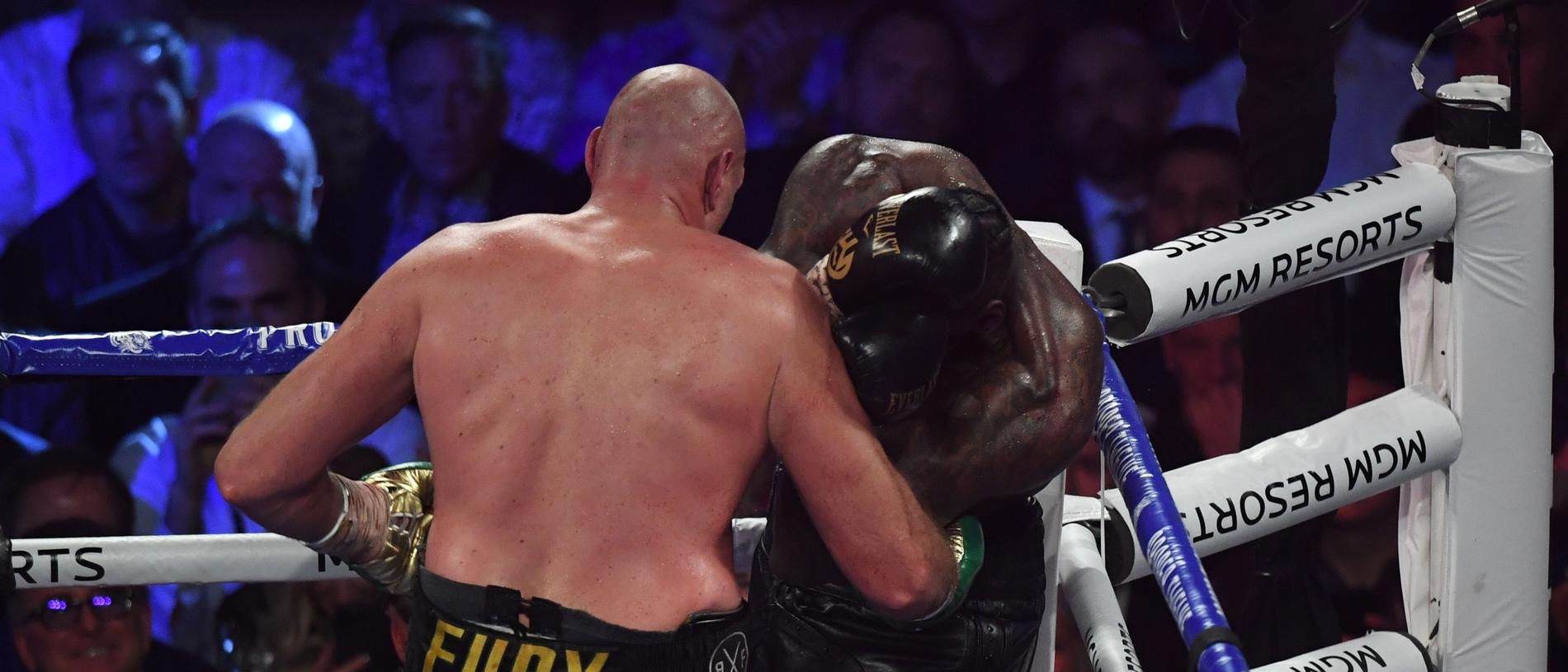 The towel (foreground) is thrown in by Wilder's trainer as British boxer Tyson Fury (L) defeats US boxer Deontay Wilder in the seventh round during their World Boxing Council (WBC) Heavyweight Championship Title boxing match at the MGM Grand Garden Arena in Las Vegas on February 22, 2020. (Photo by Mark RALSTON / AFP)