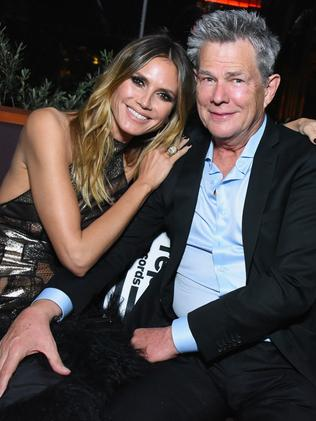 Model Heidi Klum and musician David Foster celebrate at the Republic Records after-party. Picture: Getty