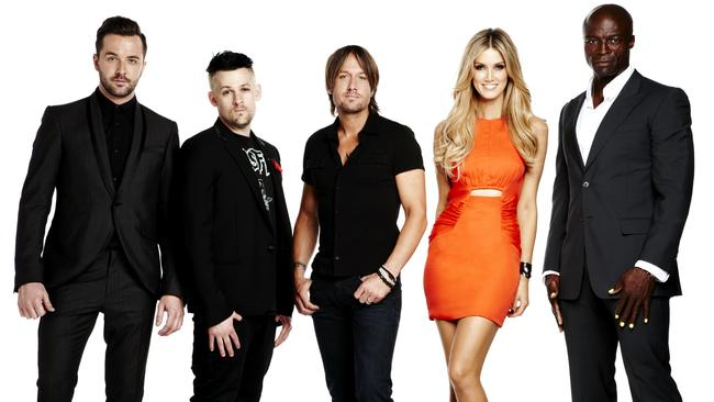 The Voice stars in season one: Darren McMullen, Joel Madden, Keith Urban, Delta Goodrem and Seal.