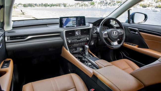 Inside the new Lexus RX 350L Sports Luxury, featuring Ochre trim and Laser Cut Wood.