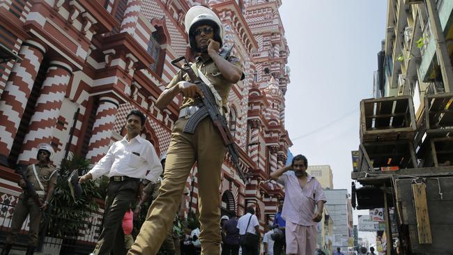 A Sri Lankan police officer patrols out side a mosque in Colombo on Wednesday. Picture: Eranga Jayawardena/AP