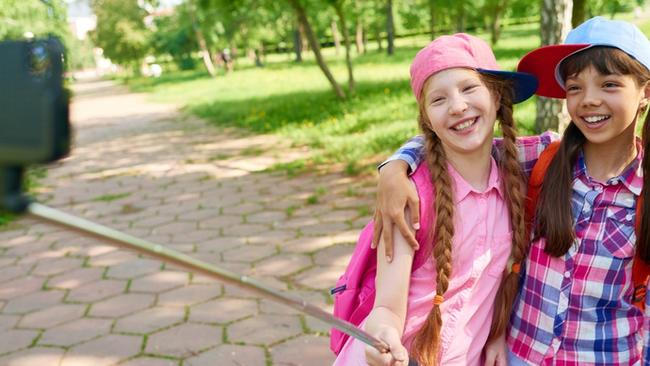 Cute photos with friends are one thing, but when your kid starts practising her duck face, it's time to hide the selfie stick. (Pic: iStock)