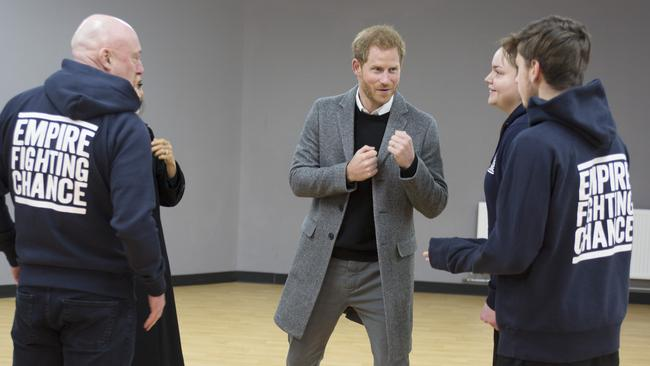 Prince Harry chatted with Iestyn Jones and Sarah Lucey during a visit to Empire Fighting Chance. Picture: Tom Pilston — WPA Pool/Getty Images