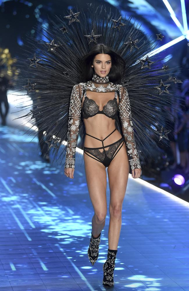Kendall Jenner looks like a bedazzled black peacock. Who borrowed some shoes from Donatella Versace.